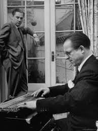 Oswald looks on as Peter Purlow assesses the zither damage.